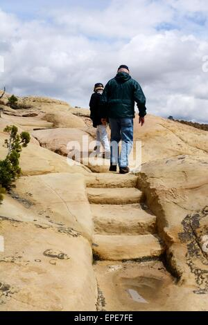 Ascending steps carved in sandstone at El Morro National Monument New Mexico - USA - Stock Photo