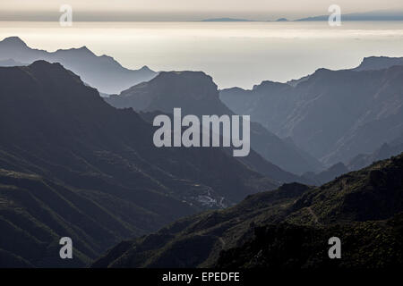 View from Roque Bentayga towards the mountains in the west of Gran Canaria, El Chorillo at the bottom, Canary Islands, - Stock Photo