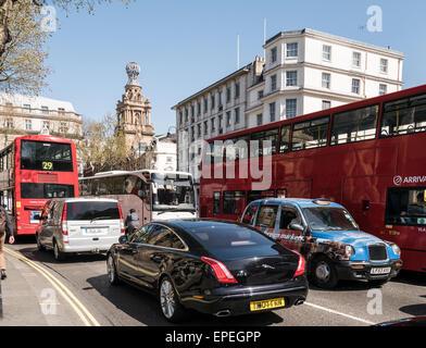 Busy traffic in Trafalgar Square London UK - Stock Photo