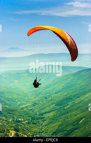 Paragliding in the valley - Stock Photo