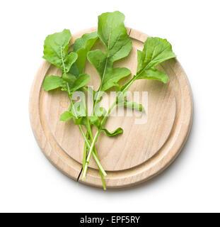 the arugula leaves on cutting board - Stock Photo