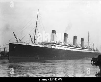 White Star Line liner RMS Olympic, sistership of the ill fated Titanic seen here in Southampton docks for her yearly - Stock Photo