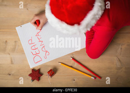 little girl writing letter to santa at christmas stock photo