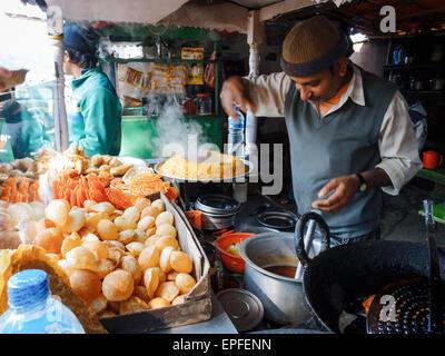 Man operating street food cart in Pokhara, Nepal - Stock Photo