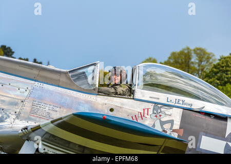 North American P-51D Mustang pilot Peter Teichman taxis in after an air display, Old Warden, Bedfordshire England - Stock Photo