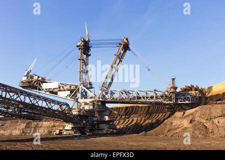 Bucket wheel excavator in a brown coal open pit mine. - Stock Photo