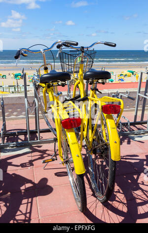 Bicycles parked near the beach of Zandvoort aan Zee in The Netherlands - Stock Photo