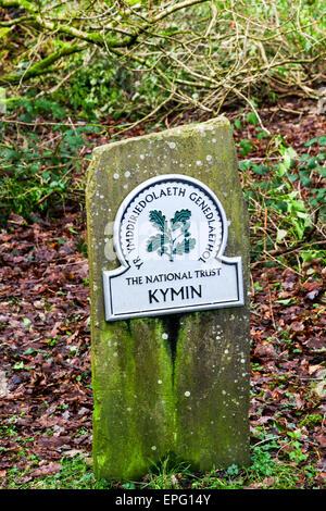 A National trust omega sign saying Kymin and Yr Ymddieriedolaeth Genedlaethol (National Trust) in welsh on Kymin - Stock Photo