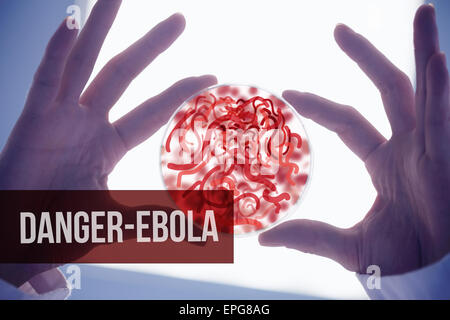Scientists hands holding petri dish of germs - Stock Photo