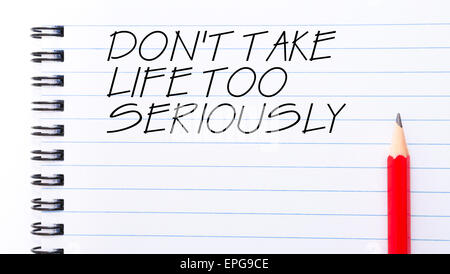 Do Not Take Life Too Seriously Text written on notebook page, red pencil on the right. Motivational Concept image - Stock Photo