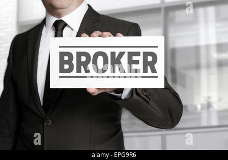 Broker sign is held by businessman - Stock Photo
