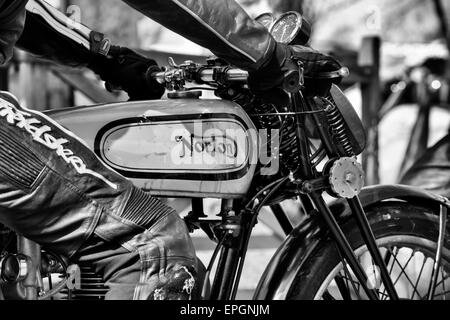 Biker on a vintage norton motorcycle. Black and white - Stock Photo