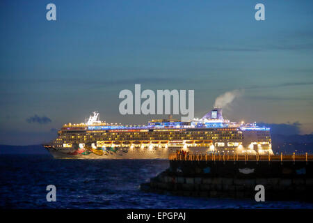 Cruise ship leaving port of Victoria at twilight-Victoria, British Columbia, Canada. - Stock Photo