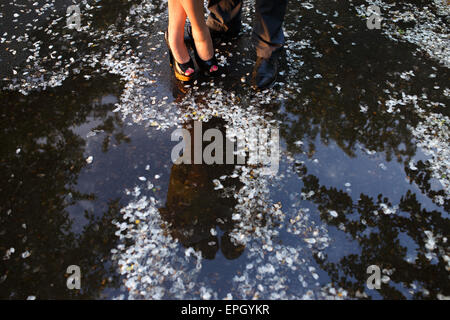legs  of couple standing near the water - Stock Photo