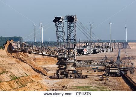 Bucket wheel excavator in brown coal open pit - Stock Photo