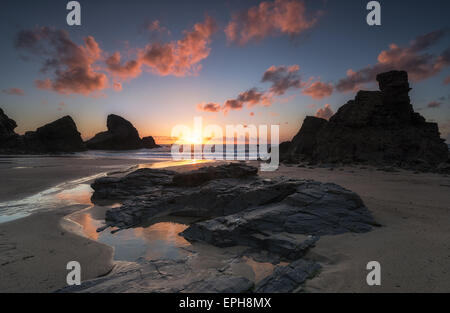Dramatic sunset at over rock stacks at Porthcothan Bay near Padstow in Cornwall - Stock Photo