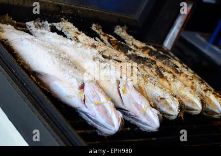 sailty grilled barramundi or Asian seabass (Lates calcarifer) at Thailand market - Stock Photo