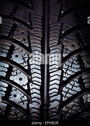 Closeup of a winter snow tire tread - Stock Photo