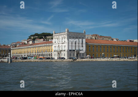 Buildings in the Praca do Comercio viewed from the River Tagus, Lisbon. - Stock Photo
