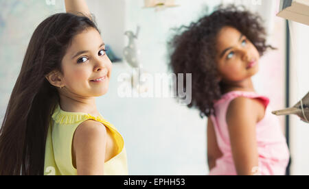Two little adorable girls playing together - Stock Photo