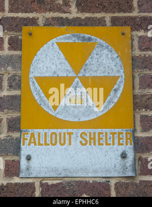 Faded fallout shelter sign. - Stock Photo