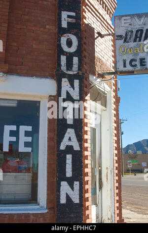 Old, painted sign on a cafe in New Mexico. - Stock Photo
