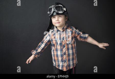 Portrait of a little cute pilot - Stock Photo