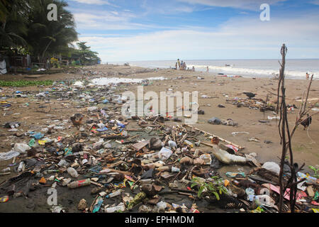 Plastic trash and other garbage on urban beach in Sumatra, Indonesia - Stock Photo