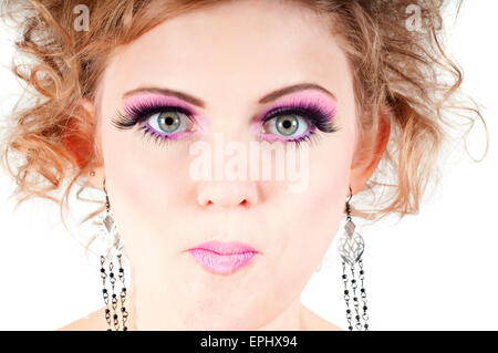 Blonde with fancy make-up grimacing - Stock Photo