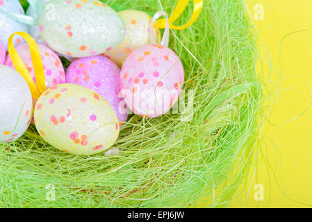 Easter eggs in green nest - Stock Photo