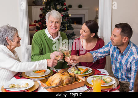 Portrait of happy family toasting at christmas dinner - Stock Photo