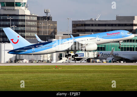 Thomson Airways Boeing 757-200 climbs away from runway 05L at Manchester airport. - Stock Photo