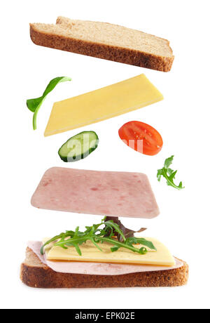 Ham and cheese sandwich ingredients falling into place - Stock Photo