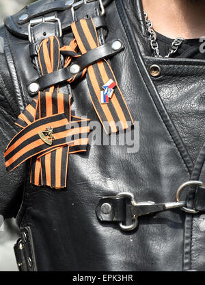 A member of the Russian motorcycle club 'Nachtwoelfe' (lit. Night wolves) wears ribbons that consist of black and - Stock Photo