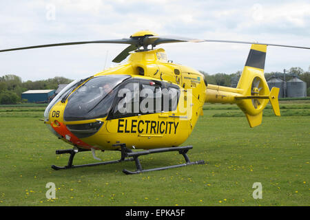 WPD Western Power Distribution EC135 helicopter used to check electricity power supply wires lines and pylons in - Stock Photo