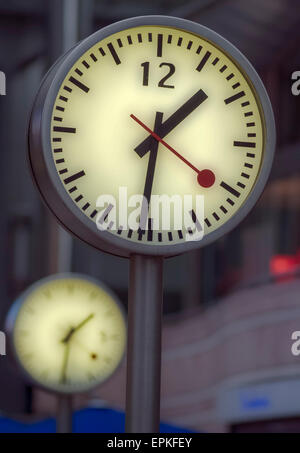 Clocks in Canary wharf, London, GB, Europe - Stock Photo