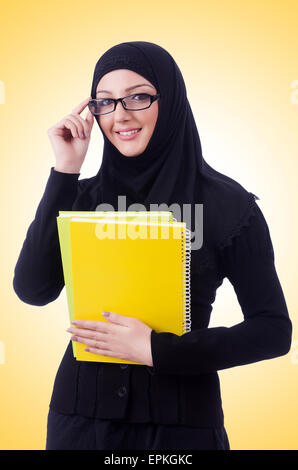 Young muslim woman with book on white - Stock Photo