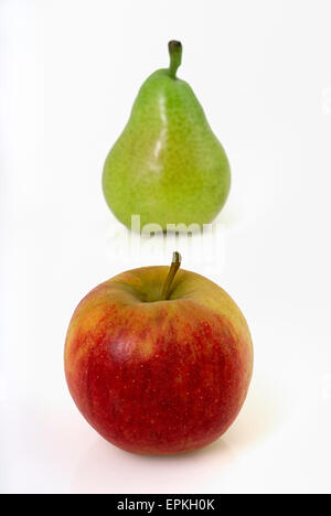 Red apple and green pear - Stock Photo