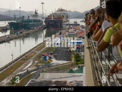 Panama, Province Of Panama, Panama City, Tourists Watching Container Ship Passing Through The Miraflores Locks In - Stock Photo