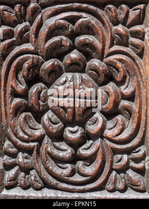 Close up photo of typical carved decorations with floral motives of an old traditional wooden door in Stone Town, - Stock Photo