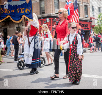 Thousands march and watch the 64th Annual 17th of May Parade in Bay Ridge, Brooklyn on May 17, 2015, celebrating - Stock Photo