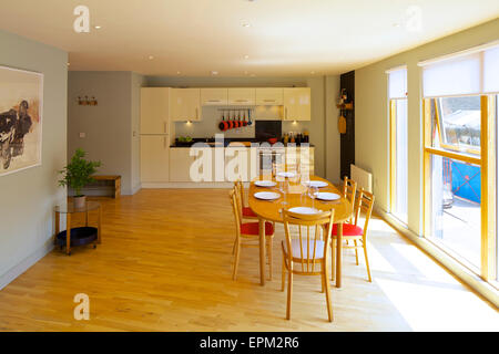 Open plan dining room and kitchen at 419 Wick Lane, London. New apartments built by Development securities Plc opposite the Olympic Stadium in London, UK.
