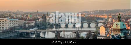 Czech Republic, Prague, cityscape with Charles Bridge at dawn - Stock Photo