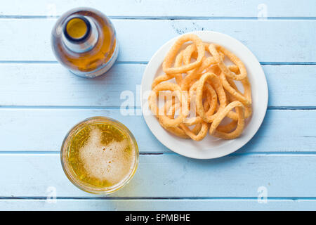 the snack flavored with onion rings - Stock Photo