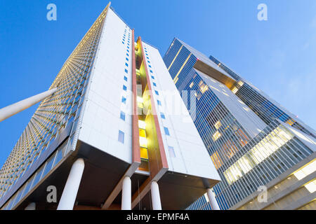 Netherlands, Rotterdam, Kop van Zuid, facades of office buildings KPN Tower and De Rotterdam - Stock Photo