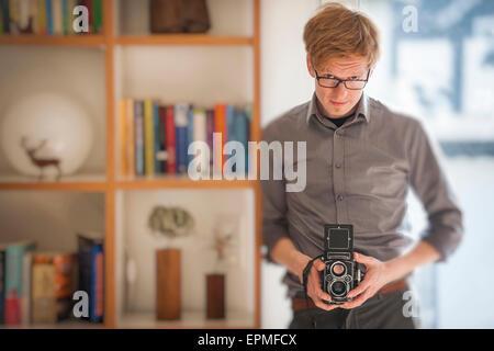 Man holding old camera - Stock Photo