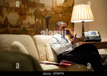 U.S. President Barack Obama talks on the phone with European leaders to consult about the situation in eastern Ukraine - Stock Photo