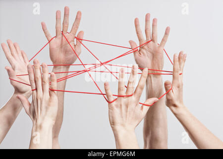 Connection, Team, Teamwork, Relationship, Hands, Cat's Cradle - Stock Photo