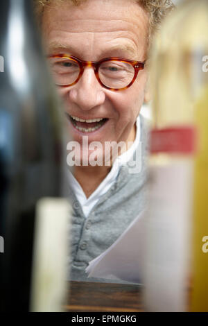 Senior man testing red and white wine - Stock Photo