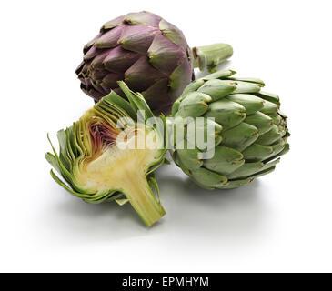 whole and half cut artichoke isolated on white background - Stock Photo